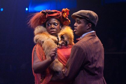 "Theresa Cunningham (as Sofia) and David Little (Harpo) perform a scene from Toby's Dinner Theatre's production of """"The Color Purple."""""