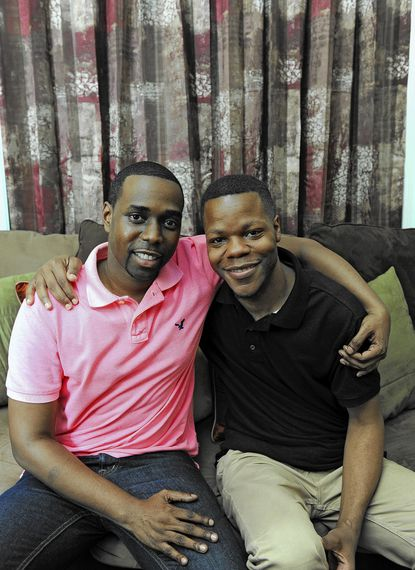 Larry Harris, 35, right, is pictured with his fiance Leonard Martin, 31, in their Baltimore home.