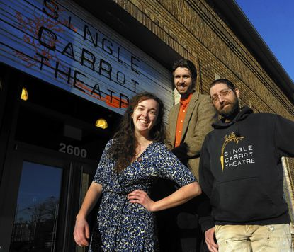 (From left) Single Carrot Theatre interim Artistic Director Kellie Mecleary; Managing Director Elliott Rauh and Technical Director Michael Varelli are pictured at the marquee of the company's first permanent home at 2600 N. Howard St. The facility opened in 2014. (Kenneth K. Lam/Baltimore Sun)