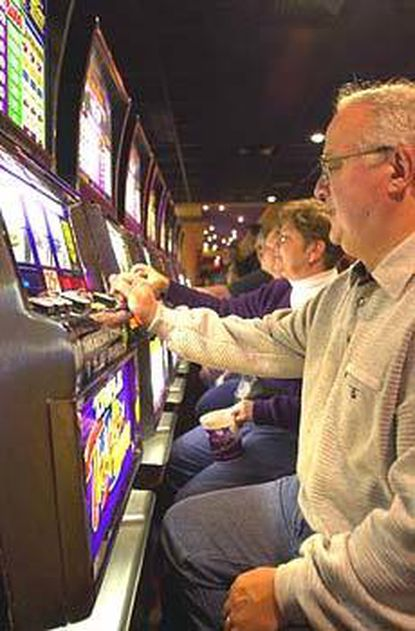 Players to Charles Town Races & Slots enjoy a day with its slot machines. A busload of Baltimore-area residents heading to the racetrack believe slots would be good for Maryland.