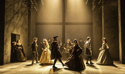"The company performs in a scene from ""Wolf Hall."""