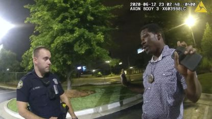 This screen grab taken from body camera video provided by the Atlanta Police Department shows Rayshard Brooks speaking with Officer Garrett Rolfe in the parking lot of a Wendy's restaurant, late Friday, June 12, 2020, in Atlanta.