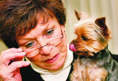 Margaret D. Rappaport, shown in a 2009 photo with her teacup Yorkshire terrier Shayna Madel, who often accompanied Rappaport at her job as Howard County Circuit Court Clerk. Rappaport announced her retirement from the post this month.