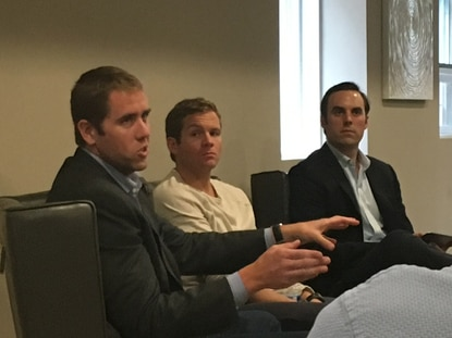 Chris Brandenburg, left, and Chris Jeffery, center, speak to entrepreneurs at a Baltimore Innovation Week event Wednesday. Brandenburg co-founded Millennial Media and Jeffery is CEO of OrderUp, both successful local startups.