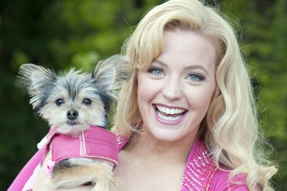 """Jessica Lauren Ball plays main character Elle Woods in the Toby''s Dinner Theatre production of """"""""Legally Blonde —-- The Musical."""""""" Here, she holds Jack, who plays Bruiser."""