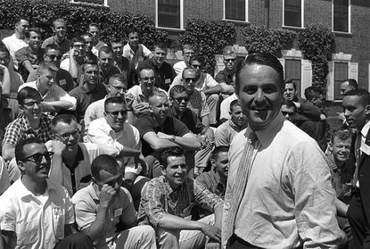 Sargent Shriver talks to prospective Peace Corps volunteers in training at Rutgers University in this 1961 file photo. Shriver died last year, and his son Mark has written a book chronicling his life and what he learned from his father. Sargent is from Carroll County.
