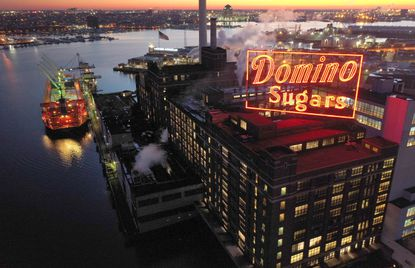 January 22 -- Domino Sugars' iconic neon sign glows at sunrise Wednesday morning. Domino is among the small number of refineries that is seeing an increase in imported sugar due to the terrible sugar beet harvest in the U.S.