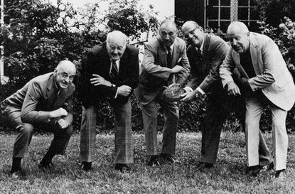 Members of Boys' Latin's 1925 football team (left to right) Richard Lee, Steuart Woodward, William Swope, Leo McCormick and William Mottu pose for a photo in 1976, 50 years after they graduated. They're posing with a deflated ball, but not the infamous one from the game they lost to Friends.