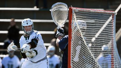 Loyola Maryland midfielder Alex McGovern, left, shoots against Georgetown on March 22, 2017. The teams will play again April 10 after this Wednesday's game was postponed because of forecasts calling for several inches of snow.