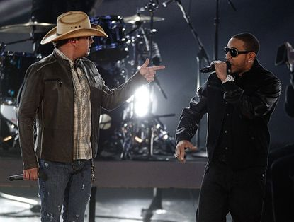 Jason Aldean, left, and Ludacris perform at the Grammy Nominations Concert on Wednesday, Nov. 30, 2011 in Los Angeles.