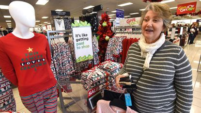 Patricia Peltz of Baltimore gets a jump on holiday shopping before Black Friday at the Kohl's in Timonium, which will open its doors at 5 p.m. on Thanksgiving, for the kickoff of Black Friday holiday shopping.