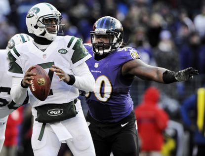 Ex-Ravens linebacker Pernell McPhee signed a five-year deal with the Chicago Bears on Wednesday.