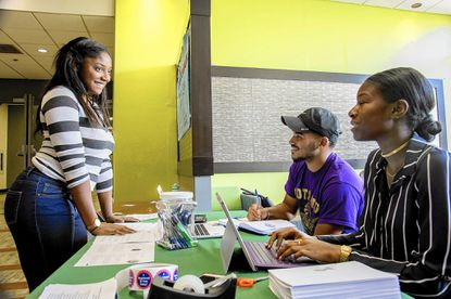Akire Gaines '20 from Norwalk, Conn. registers to vote with Wayne Long '18 (Omega Psi Phi) and Annaya Andrews (G.I.R.L.)