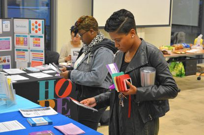 University of Maryland, Baltimore County junior Cierra Pope, of Clinton, checks out literature distributed at the a Dating Violence Awareness Night hosted at the school Thursday, Oct. 27.