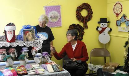Brenda Sebly, left, and Diane Staiger are shown in the Ebenezer United Methodist Church craft room during last year's Holly Mart.