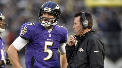 Ravens quarterback Joe Flacco, left, and offensive coordinator Gary Kubiak talk during the game Sunday against the Cleveland Browns.