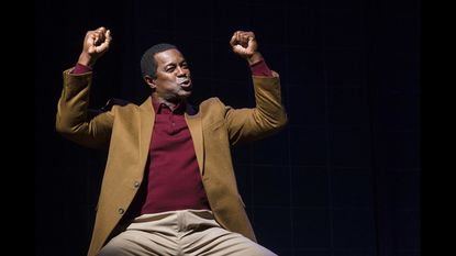 """A production photo of former NFL player Dwight Hicks in """"X's and O's."""""""