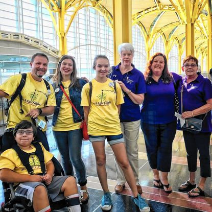 The Hatcher family, of Towson, readies to board its flight to Florida on Sept. 22. From left are, Simon Hatcher, Brian Hatcher, Laura Hatcher, Olivia Hatcher and, from the Casey Cares Foundation send-off team, Terry Tacka, Dawn Weissman, and Carol Shutt.