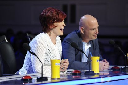 Sharon Osbourne and Howie Mandel seem amused and maybe impressed.