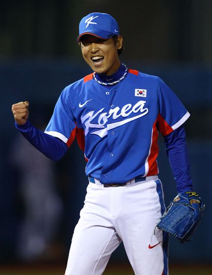 Suk-min Yoon of South Korea reacts as he helped his team win the gold medal in the 16th Asian Games Guangzhou in 2010.