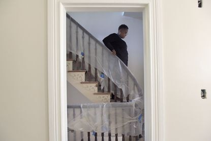 Shauntee Daniels, executive director of Baltimore National Heritage Area, descends the staircase of the H L. Mencken residence. The historic home on Union Square is in the final phase of a major renovation.
