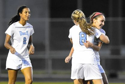 Westminster freshman Regan Miller, right, celebrates with teammates Mackenzie Miller (8) and Erika Lewis (2) after scoring a goal in the first half of the Owls' 3-1 win over South Carroll in Westminster Monday, Oct. 12, 2015.