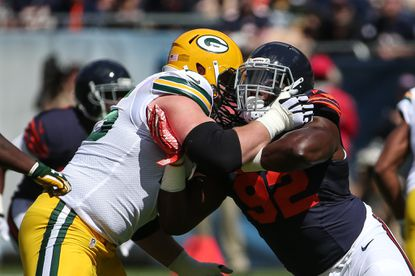 Pernell McPhee (right) of the Chicago Bears rushes against Bryan Bulaga of the Green Bay Packers on Sunday.