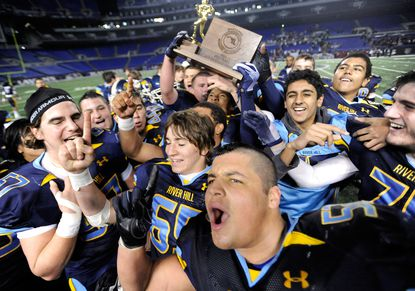 River Hill players celebrate their 41-13 victory over Thomas Johnson in Class 3A state football championship game at M&T Bank Stadium Saturday night.