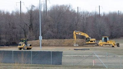 Construction crews perform site preparation and grading work Wednesday afternoon at the site of the new Havre de Grace Middle/High School near the Havre de Grace Activity Center off of Lewis Lane.