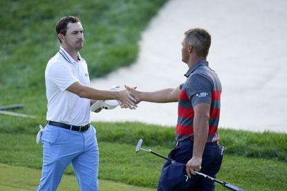 Patrick Cantlay, left, and Bryson DeChambeau shake hands after they completed the 18th hole tied to go into playoff play during the final round of the BMW Championship golf tournament, Sunday, Aug. 29, 2021, at Caves Valley Golf Club in Owings Mills. (AP Photo/Julio Cortez)