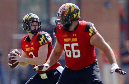 Maryland quarterback Caleb Rowe, back left, throws to a receiver behind offensive lineman Andrew Zeller in the first half against South Florida, Saturday, Sept. 19, 2015, in College Park.