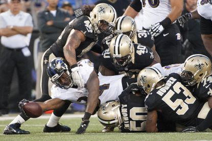 Ravens running back Lorenzo Taliaferro #34 is tackled by New Orleans Saints defense.