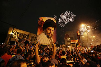 Shiite cleric Muqtada al-Sadr takes surprise lead in Iraq's election as prime minister falters