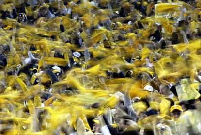 "Steelers fans wave their ""Terrible Towels"" during their win against the Ravens on Oct. 31, 2005, at Heinz Field."