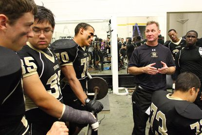 Ross Hannon, seen on the right talking to his team as head coach at Mt. Hebron in 2009, has been hired as the next head varsity football coach at Howard High School.