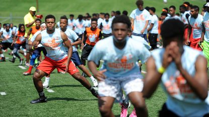 Football players ages 8-18 participate in the free Fuller Family Football Camp at Woodlawn High School on Saturday, July 11, 2015.