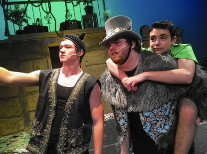 """From left: Luke Gore, Tom Eppley and Aidan Russell rehearse a scene from """"The Jungle Book KIDS"""" at Winters Mill High School."""