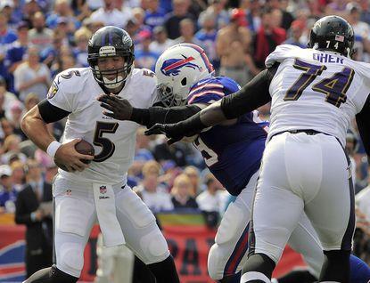 Ravens quarterback Joe Flacco is sacked by Bills defensive tackle Marcell Dareus.