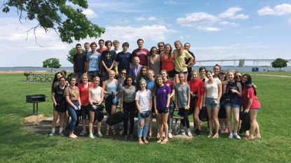 Broadneck High School Students clean up Sandy Point State Park, directed by Brynn Bogarde (top row, second from right).