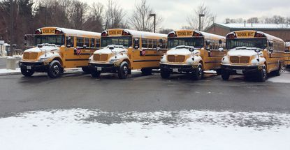 Baltimore County school buses sit in a bus lot after school was cancelled for snow.