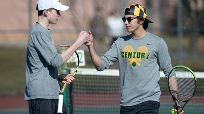 Century's Luke Fetterman, left, and John Marcellino celebrate a point during their doubles match against Manchester Valley's Sean McGarry and Mason Castanzo in Eldersburg Monday, March 26, 2018.