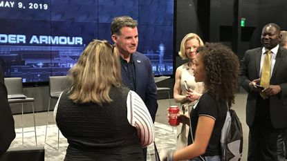 Football-playing teenage girl makes plea to Under Armour at annual meeting