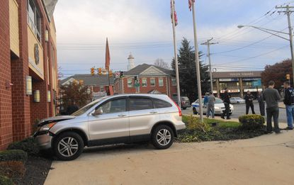 Bel Air Police are investigating why a car ran into the town's main firehouse on Hickory Avenue late Monday afternoon.