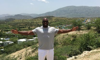 Ravens pass rusher Elvis Dumervil stands in Haiti, where he's helping to build homes.
