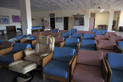 Chairs are packed into a room at the former Salvation Army Adult Rehabilitation Center on March 11, 2021. (Karl Merton Ferron/Baltimore Sun Staff)