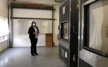 Dorota W. Marshall, owner of Maryland Cremation Services, stands in the crematorium on April 17, 2020.