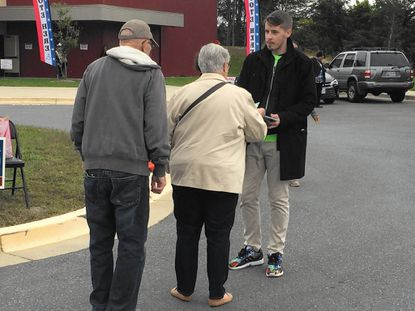 Prince George's County school board candidate David Murray, who is running uncontested, campaigns outside the Laurel-Beltsville Senior Activity Center Thursday afternoon in Laurel on the first day of early voting.