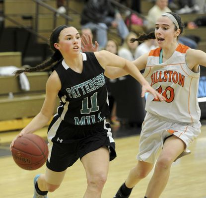 Patterson Mill's Samantha Herman is guarded by Fallston's Kayla Reilly in the Upper Chesapeake Bay Athletic Conference girls basketball championship game at C. Milton Wright.