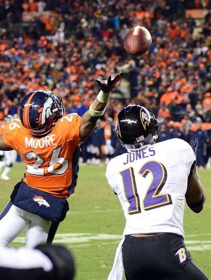 Ravens wide receiver Jacoby Jones catches a touchdown behind Denver safety Rahim Moore in the AFC divisional round game.