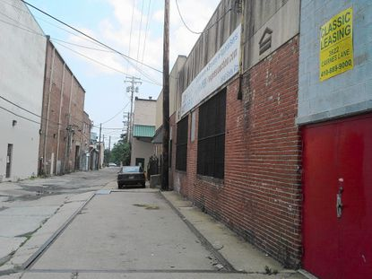 Cairnes Lane, a glorified alley that runs parallel to Falls Road near The Avenue, West 36th Street in Hampden, would be the setting for 29 row houses in a planned development that some of the area's merchants say could add to their customers' parking woes.